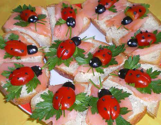 Ladybugs made out of tomatoes, cheese and olives
